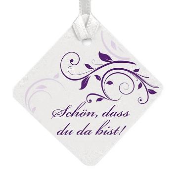Geschenkkärtchen mit lila Schnörkeln und Text